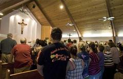 <p>Parishioners pray during a mass in Whitesville, West Virginia April 6, 2010. REUTERS/Chris Keane</p>