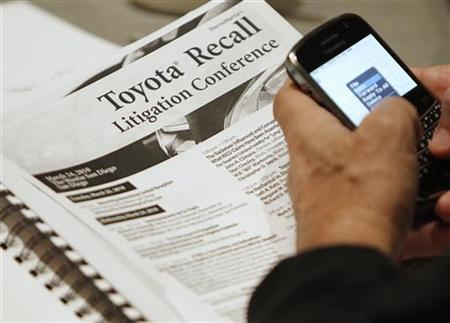 A lawyer goes over an information packet as he attends a conference to strategize on how best to sue Toyota Motor Corp. at a hotel in downtown San Diego, California March 24, 2010. REUTERS/Mike Blake