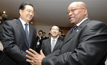 China's President Hu Jintao (L) shakes hands with his South African counterpart Jacob Zuma during the BRIC summit in Brasilia April 15, 2010. REUTERS/Paulo Whitaker
