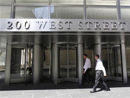 People walk past revolving doors of the new Goldman Sachs Group Inc. global headquarters, also known by its address as 200 West Street, in New York's lower Manhattan April 7, 2010. REUTERS/Brendan McDermid