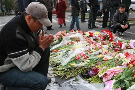 A man prays as he grieves at the central square of Bishkek commemorating victims of the unrest, April 17, 2010. REUTERS/Vladimir Pirogov