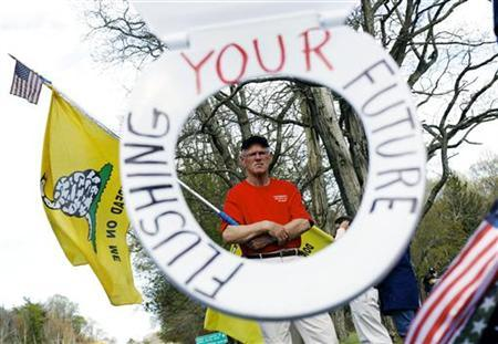 Tea Party activist John Brady, from Wantagh, New York, demonstrates during a tax day rally outside the Korean War Memorial in Hauppauge, New York April 15, 2010. REUTERS/Shannon Stapleton