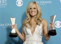 <p>Carrie Underwood poses with her Entertainer of the Year award and the Triple Crown award at the 45th annual Academy of Country Music Awards in Las Vegas, Nevada April 18, 2010. REUTERS/Steve Marcus</p>