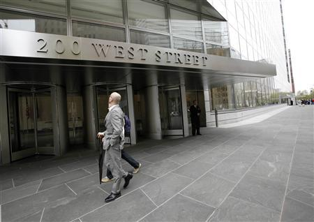 People walk past revolving doors of the new Goldman Sachs Group Inc. global headquarters, also known by its address as 200 West Street, in New York's lower Manhattan, April 16, 2010. REUTERS/Brendan McDermid