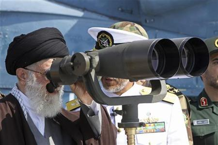 Iran's Supreme Leader Ayatollah Ali Khamenei looks through field glasses as he visits the country's first domestically-made destroyer, Jamaran, which was launched in undisclosed waters in the Persian Gulf, in south Iran, February 19, 2010. REUTERS/Khamenei.ir/Handout
