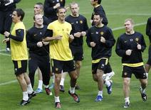 """<p>""""Манчестер Юнайтед"""" тренируется в Мюнхене 29 марта 2010 года. Самым дорогим футбольным клубом в мире является английский """"Манчестер Юнайтед"""", который специалисты журнала Forbes оценили в $1,8 миллиарда. REUTERS/Michaela Rehle</p>"""