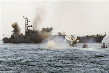 An Iranian warship and speed boats take part in a naval war game in the Persian Gulf and the Strait of Hormuz, southern Iran April 22, 2010. REUTERS/Fars News