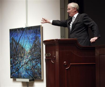 Auctioneer Christopher Burge calls out bidders while selling lot number 15, an untitled oil painting by artist Zeng Fanzhi, during Christie's Green Auction on the 40th anniversary of Earth Day, in New York, April 22, 2010. REUTERS/Chip East