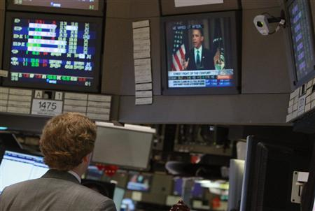 A trader on the floor of the New York Stock Exchange watches a screen showing U.S. President Barack Obama's speech at Cooper Union in New York, April 22, 2010. REUTERS/Brendan McDermid