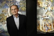 <p>Pal Sarkozy, father of the France's President Nicolas Sarkozy, poses in front of his paintings during an interview with Reuters at the Espace Pierre Cardin in Paris April 23, 2010. REUTERS/Benoit Tessier</p>