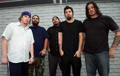 "<p>The Deftones (L-R) drummer Abe Cunningham, guitarist Stephen Carpenter, keyboardist Frank Delgado, singer Chino Moreno, and bassist Chi Cheng, pose backstage before headlining X-treme Radio's ""Our Big Concert 6,"" a day-long music festival at Sam Boyd Stadium in Las Vegas, Nevada, May 17, 2003. REUTERS/Ethan Miller</p>"
