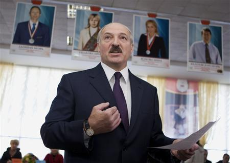 Belarussian President Alexander Lukashenko speaks to media at a polling station during local election in Minsk, April 25, 2010. REUTERS/Vasily Fedosenko