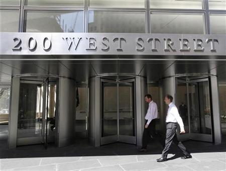 People walk past revolving doors of the Goldman Sachs headquarters in lower Manhattan, April 7, 2010. REUTERS/Brendan McDermid