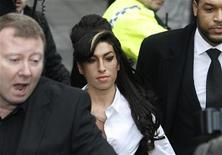 <p>British singer Amy Winehouse arrives at Milton Keynes Magistrates' Court, southern England, January 20, 2010. REUTERS/Suzanne Plunkett</p>