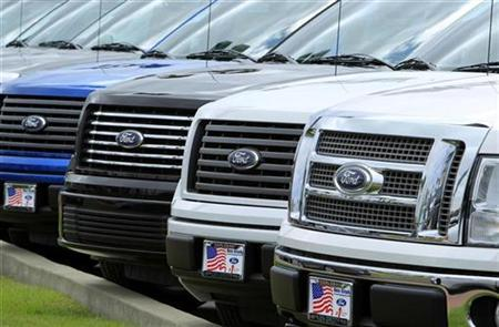 Ford trucks are shown for sale on a car lot in Carlsbad, California March 30, 2010. REUTERS/Mike Blake