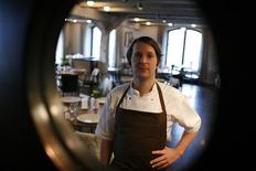 <p>Chef Rene Redzepi is seen through a window as he poses in the kitchen of his restaurant Noma in Copenhagen in this December 12, 2009 file photograph. REUTERS/Christian Charisius</p>