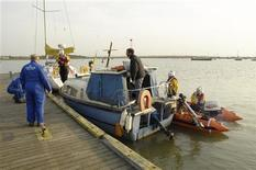 <p>A boat is rescued by a Sheerness lifeboat in this handout photo. REUTERS/Barry Crawford/Handout</p>