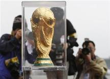 <p>Photographers take pictures of the FIFA World Cup trophy upon its arrival at Tokyo's Haneda airport during the Trophy Tour in Tokyo April 23, 2010. REUTERS/Toru Hanai</p>