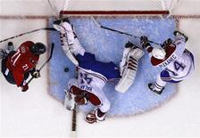 <p>Montreal Canadiens goalie Jaroslav Halak makes a save on Washington Capitals Brooks Laich as Tomas Plekanec moves in during Game 7 of their NHL Eastern Conference quarter-final hockey game in Washington April 28, 2010. REUTERS/Molly Riley</p>