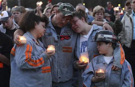 Terry Cooper, his wife Michele, daughter Tera, 16, and his son Justin, 11, comfort each other during a candlelight vigil in Montcoal, West Virginia April 10, 2010. REUTERS/John Gress