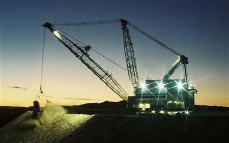 An excavator works at a Rio Tinto coal mine in the Hunter valley north of Sydney in this undated handout photograph obtained May 2, 2010. Australia will impose a new 40 percent tax on mining projects from July 2012 and boost pension savings for workers under a sweeping pre-election overhaul of its tax system, unveiled on Sunday. The new Resource Super Profits Tax will anger big miners such as BHP Billiton and Rio Tinto and is set to raise about A$12 billion ($11 billion) in its first two years. REUTERS/RIO TINTO/Handout