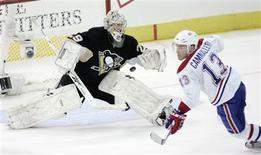 <p>Montreal Canadiens Michael Cammalleri (13) skates past Pittsburgh Penguins goalie Marc-Andre Fleury (29) as the puck bounces out of the net after he scored in the third period of Game 2 of their NHL Eastern Conference semi-final hockey game in Pittsburgh, Pennsylvania, May 2, 2010. REUTERS/Jason Cohn</p>