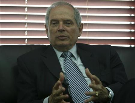 Colombia's Mines and Energy Minister Hernan Martinez gestures during an interview with Reuters in Bogota May 3, 2010. REUTERS/John Vizcaino