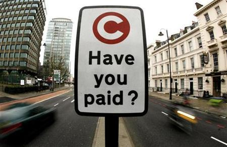 A congestion charge pay reminder sign is seen in London in this February 19, 2007 file photo. REUTERS/Alessia Pierdomenico/Files