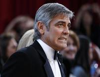 """<p>Американский актер Джордж Клуни на церемонии вручения наград киноакадемии США в Голливуде 7 марта 2010 года. 6 мая 1961 года родился популярный голливудский актер Джордж Клуни, сыгравший, в частности, в таких лентах, как """"От заката до рассвета"""" Квентина Тарантино, """"О, где же ты, брат?"""" братьев Коэн, а также трилогии про """"друзей Оушена"""" Стивена Содерберга REUTERS/Lucas Jackson</p>"""