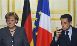 <p>Archivaufnahme von Bundeskanzlerin Angela Merkel und dem französischen Präsidenten Nicolas Sarkozy in in Paris am 4. Februar 2010. REUTERS/Philippe Wojazer</p>