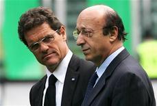 <p>7 maggio 2006, l'ex allenatore juventino Fabio Capello e l'ex dg Luciano Moggi. REUTERS/Max Rossi</p>