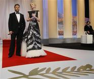 <p>Jury president Tim Burton (R) looks on Cast members Cate Blanchett and Russell Crowe (L) attend the opening ceremony of the 63rd Cannes Film Festival May 12, 2010. REUTERS/Yves Herman</p>