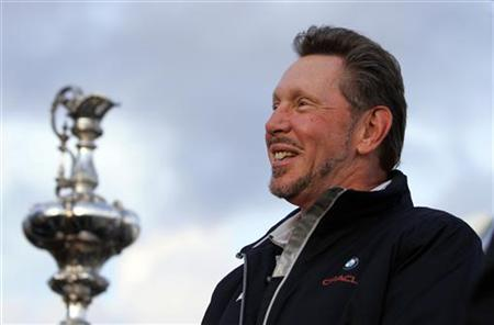 Larry Ellison, owner of BMW Oracle, winner of the 33rd America's Cup, stands next to the America's Cup on the USS Midway in San Diego, California February 21, 2010. REUTERS/K.C. Alfred