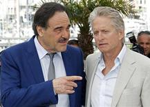 "<p>Cast member Michael Douglas (R) attends a photocall for the film ""Wall Street - Money never sleeps"" by U.S. director Oliver Stone (L), during the 63rd Cannes Film Festival in Cannes, May 14, 2010. REUTERS/Jean-Paul Pelissier</p>"