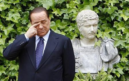 Italian Prime Minister Silvio Berlusconi rubs his eye as he waits for the arrival of Emir of Kuwait, Sheikh Sabah Al-Ahmad Al-Jaber for a meeting at Villa Madama in Rome May 4, 2010. REUTERS/Max Rossi