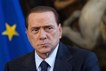 Italy's Prime Minister Silvio Berlusconi looks on during a meeting with his Lebanese counterpart Saad al-Hariri (not seen) at Chigi palace in Rome April 20, 2010. REUTERS/Max Rossi