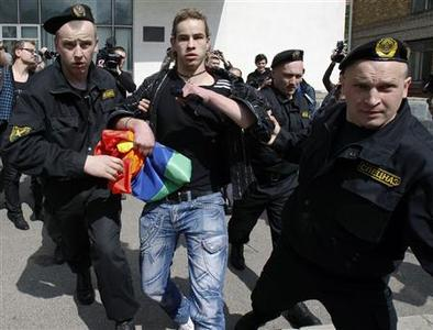 Policemen detain a gay rights activist during an unsanctioned Gay, Lesbian and Bisexual Pride Parade in the capital Minsk May 15, 2010. REUTERS/Vasily Fedosenko