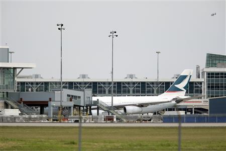 A Cathay Pacific airplane sits at the terminal at Vancouver International Airport in Richmond, British Columbia May 15, 2010. REUTERS/Lyle Stafford