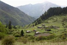 "<p>The abandoned Tibetan village of Heijiao nestles in the mountains of Jiuzhaigou National Park, Sichuan province May 12, 2010. Li Jianyu, manager of the nature reserve's pioneering eco-tourism project in neighbouring Zharu valley, hopes he might one day be able to take visitors to Heijiao. He says its name means ""paradise"" in Tibetan. REUTERS/Stringer</p>"