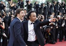 "<p>Director Alejandro Gonzalez Inarritu (R) poses with cast member Javier Bardem as they arrive on the red carpet for the screening of his film ""Biutiful"" in competition at the 63rd Cannes Film Festival May 17, 2010. REUTERS/Yves Herman</p>"