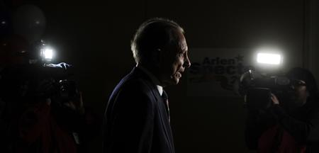 Sen. Arlen Specter (D-PA) walks past television cameras following a news conference with the media at his campaign reception hall in Philadelphia, May 18, 2010. REUTERS/Bradley Bower