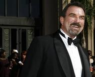 <p>Actor Tom Selleck smiles as he arrives at the 58th annual Primetime Emmy Awards at the Shrine Auditorium in Los Angeles August 27, 2006. REUTERS/Mario Anzuoni</p>