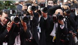 <p>Press photographers take pictures of guest walking on the red carpet ahead of the screening of the film Poetry in competition at the 63rd Cannes Film Festival, May 19, 2010. REUTERS/Yves Herman</p>
