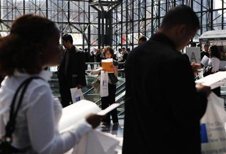 People wait in line to enter the City University of New York (CUNY) Big Apple job fair in New York in this April 23, 2010 file photo. REUTERS/Shannon Stapleton