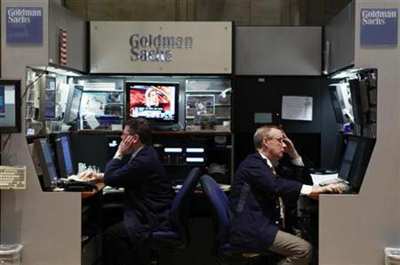 Traders work in the Goldman Sachs booth on the floor of the New York Stock Exchange in New York May 10, 2010. REUTERS/Lucas Jackson