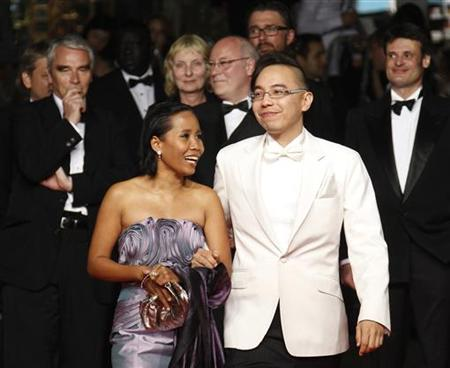 Director Apichatpong Weerasethakul (2nd R) and cast member Wallapa Mongkolprasert arrive for the screening of ''Lung Boonmee Raluek Chat'' (Uncle Boonmee Who Can Recall his Past Lives) in competition at the 63rd Cannes Film Festival May 21, 2010. REUTERS/Yves Herman