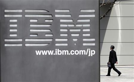 A man walks past the headquarters of IBM Japan in Tokyo March 18, 2010. REUTERS/Toru Hanai