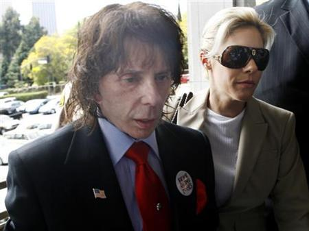 Music producer Phil Spector and wife Rachelle arrive at the criminal courts building in Los Angeles in this April 13, 2009 file photo. REUTERS/Fred Prouser