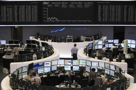 Traders work at their desks in front of the DAX board at the Frankfurt stock exchange May 25, 2010. REUTERS/Remote/Fabrizio Bensch