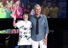 <p>Greyson Chance is seen with Ellen DeGeneres in this undated handout photo. REUTERS/Handout</p>